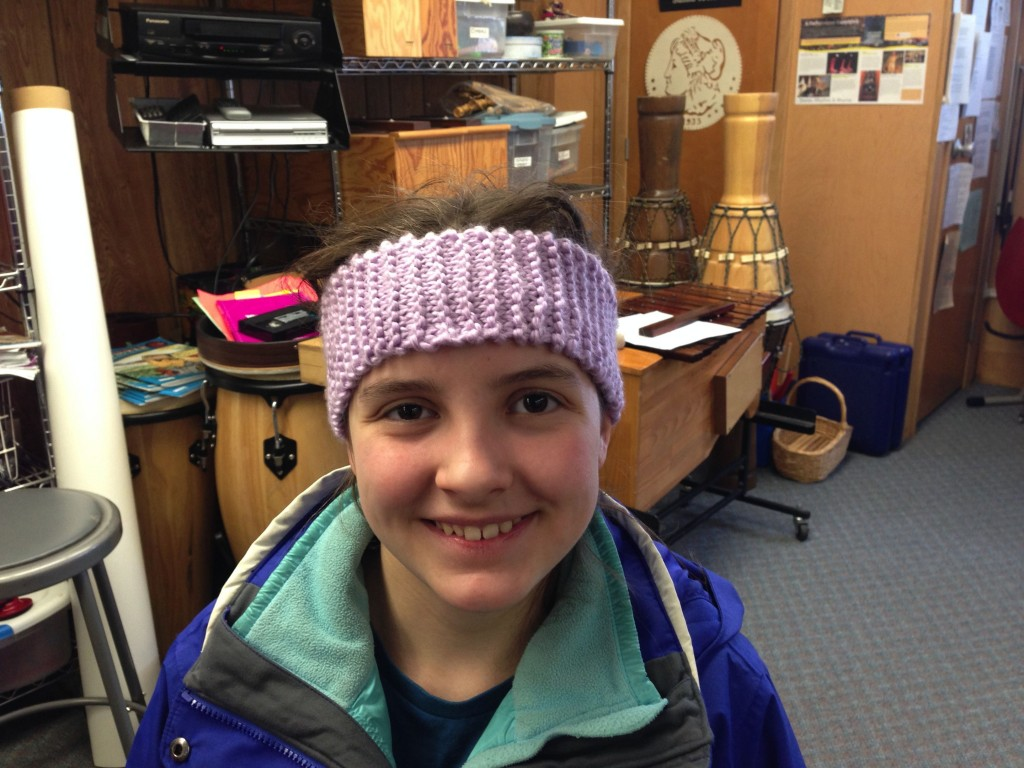 Olivia proudly wearing the  headband she made in class!