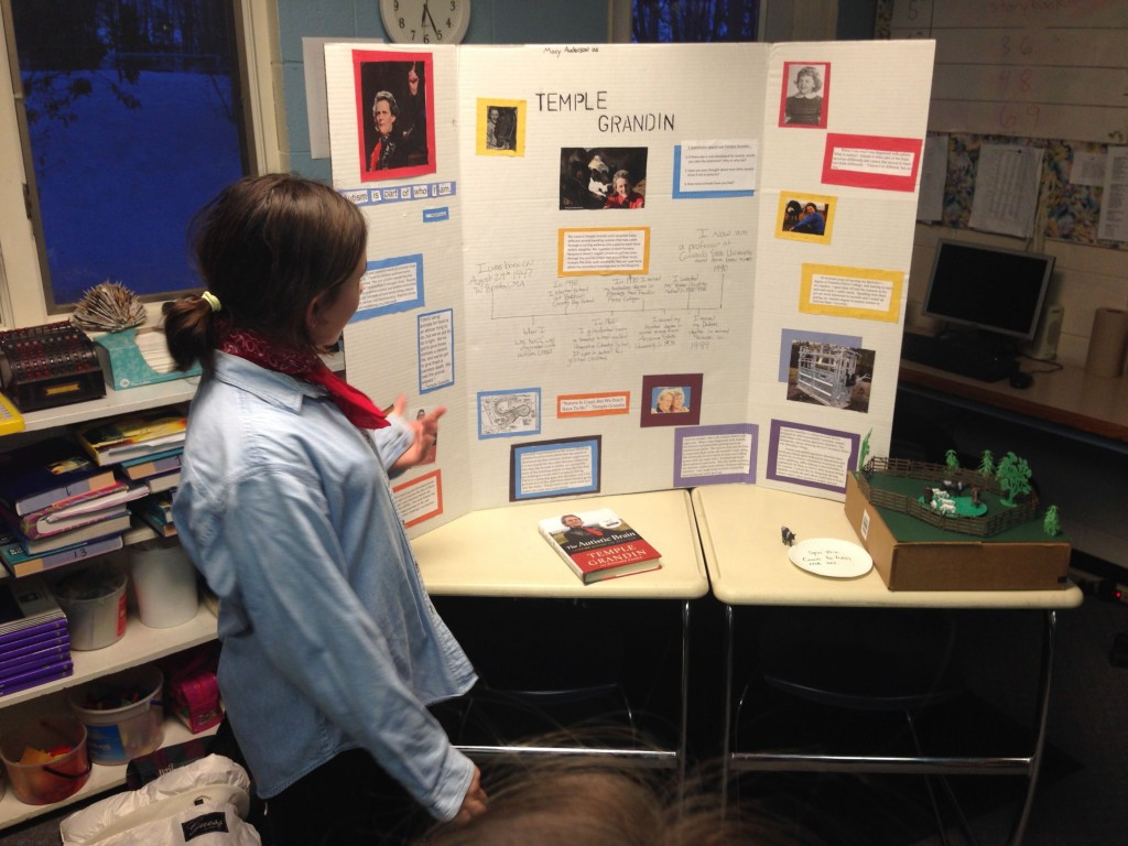 Macy as Temple Grandin explaining her inventions for animals.