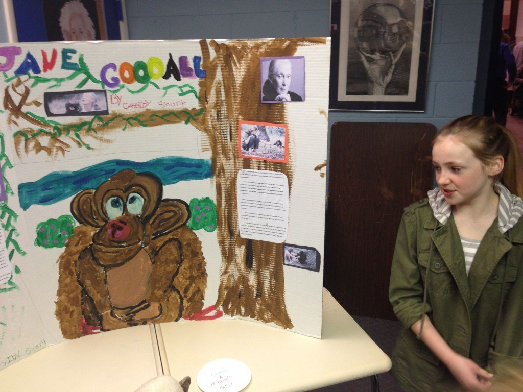 Cassidy portraying Jane Goodall with her awesome hand painted poster!