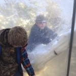 Gabe and Dakota using the forces of pull and push to clean the snow off the sides