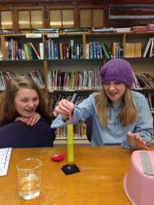 Cassidy and Emlin finding the volume of chewed gum - yuk!